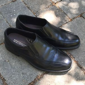 Men's black leather dress shoes.